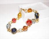 Multi-Color Wire Wrapped Glass Bead and Golden Bracelet