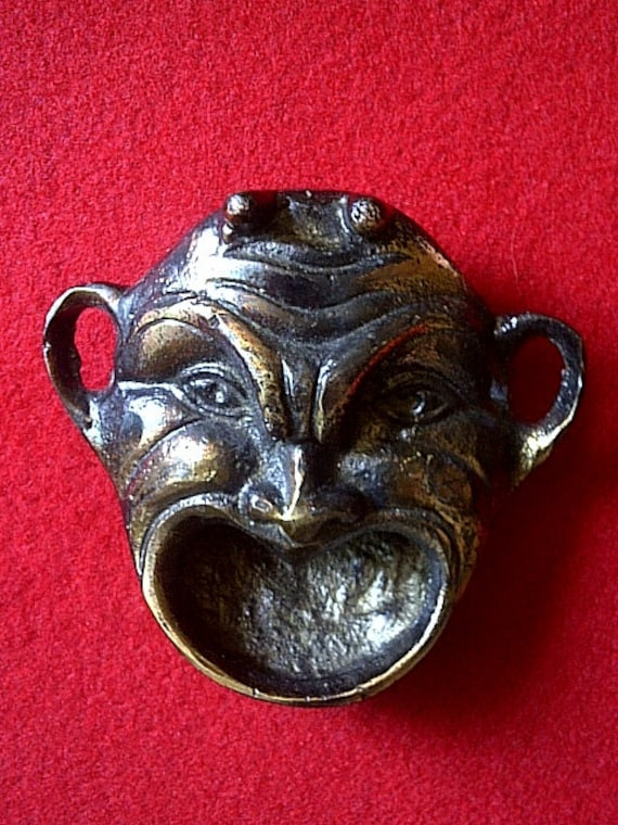 Little Devil, a Figural Bottle Opener, Made of Brass with a copper finish, or an ashtray, incense burner.