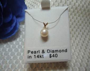 Pearl and Diamond Pendant in 14 kt Yellow Gold