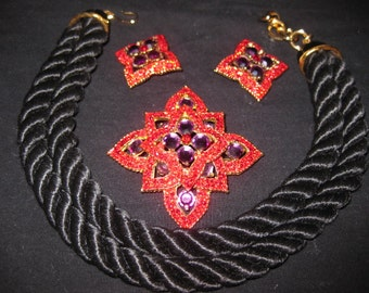 Red and purple rhinestone necklace/brooch and earrings.