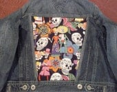 Upcycled Womens/Junior Denim Tommy Hilfiger Jacket size L with Fun Grunge Skull fabric on  the back and the pockets.
