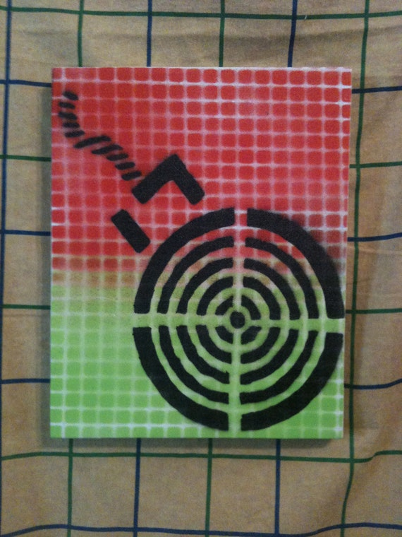 target Bomb stencil spray painted onto small canvas