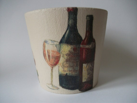 Clay flower pot decorated with wine bottles by potsbydesignuk for Wine bottles decorated with flowers