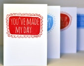 """Hand Printed Greetings Card - """"You've made my day"""" printed in ruby red on white"""
