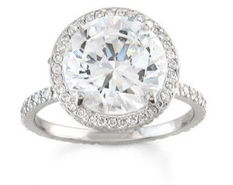 Ladies 14 kt white gold diamond halo engagement ring with 2 ct natural Round white sapphire center and 0.50 ctw G-VS2 diamonds