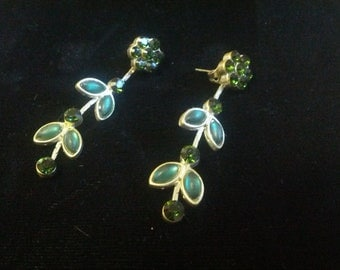 Exquisite dangle earrings set in gold tone with green crystals