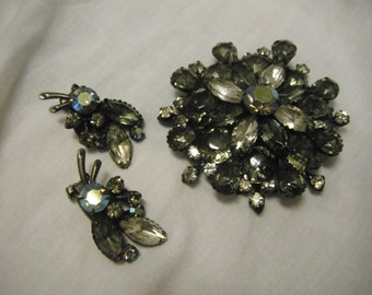 Vintage dark rhinestone brooch with matching clip-on earrings