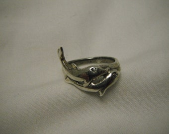 Swimming dolphins sterling silver ring