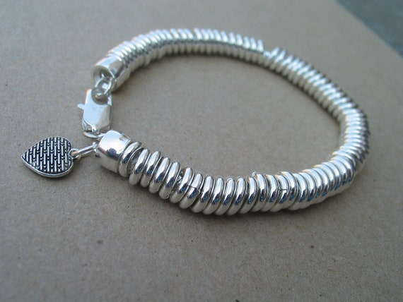 Silver solid bracelet with links and heart charm