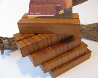 Five wood business card holders, custom made from roasted curly maple.