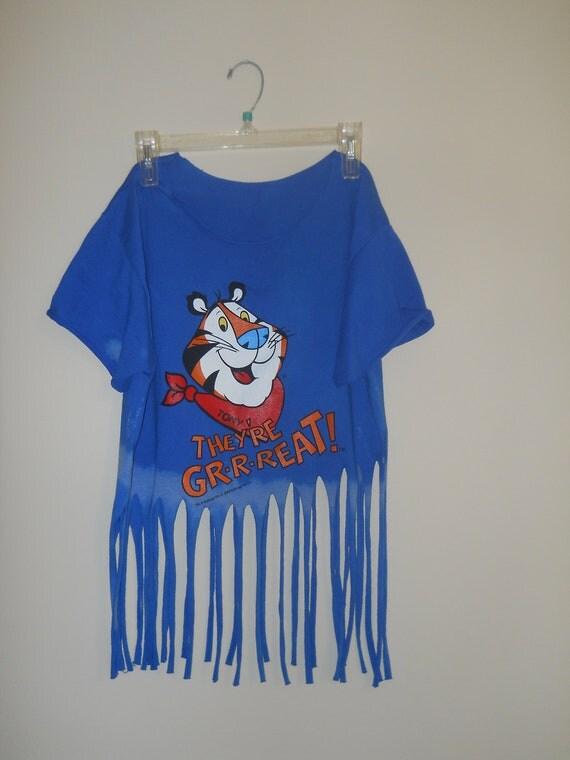 90s vintage indie grunge hipster baggy blue Tony Tiger ombre bleached fringe cutoff festival shirt