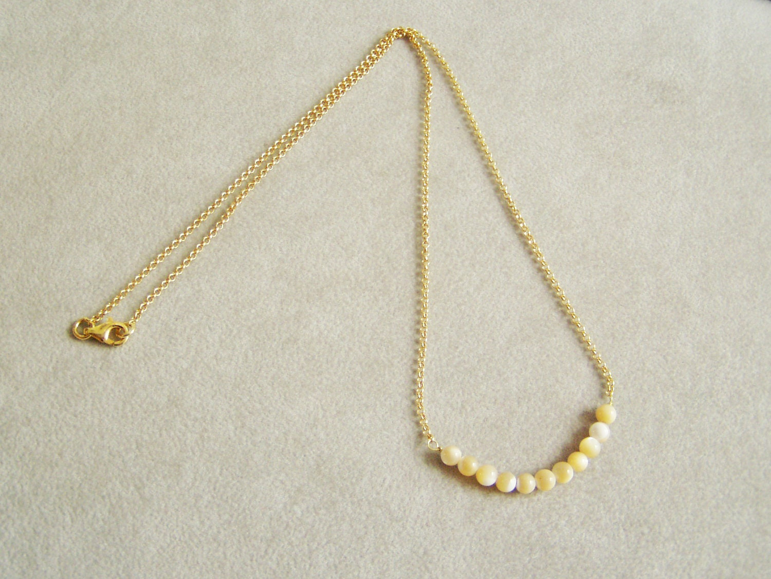 Thin golden chain necklace, mother of pearl beads, sterling ...