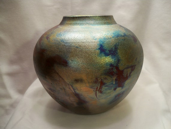 Beautiful handmade ceramic raku vase, with bright metallic colors