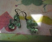 Three tiered earrings feature jade glass droplets