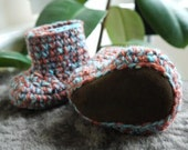 Pure wool and sheepskin two tone baby booties turquoise and pumpkin.