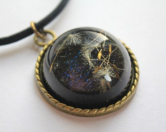 Beautiful Real Dandelion Seeds encased in a Dark Green Glitter Glass Dome, attached to Leather and Bronze Necklace