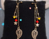 Bronze earrings with CLIPS, long chain feather and crystal beads red & yellow