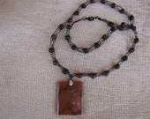 "Black knit wire with brown beads and 2"" brown agate pendant. 23 inch length plus pendant."