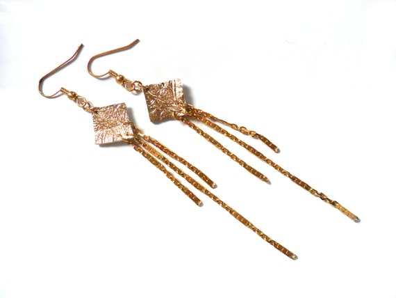 Gold shooting star leather and chain earrings