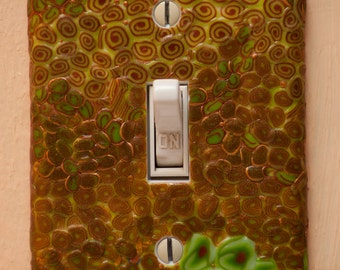 Glow in the dark, gold and spring green Klimt-inspired polymer clay switchplate cover