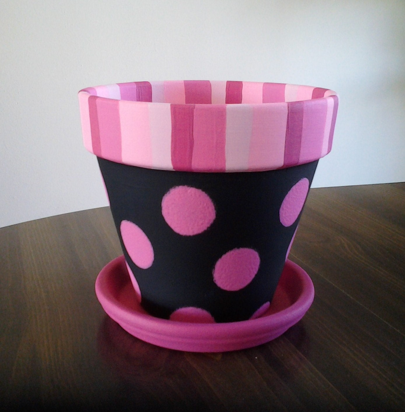 Pink polka dots on black painted clay pot with by emmajosattic for Design patterns for pot painting