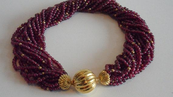 stunning   18k vintage  gold garnet  beads trident mark 18k comes with papers torsade necklace