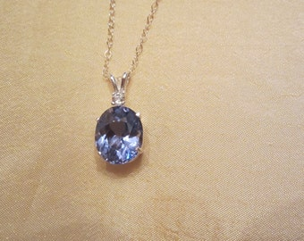 Beautiful Top Swiss Blue Oval Accented Spinel Pendant