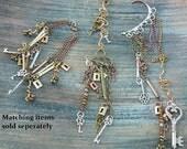 steampunk ear cuff wrap copper mixed metals keys lock charms in gypsy boho hippie gothic and fantasy style