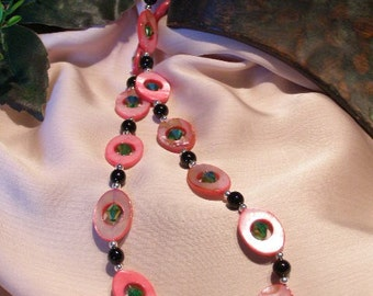 N0009. Vibrant shades of pink, black and green will make you think of watermelons.