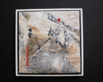 mixed media collage with textured papers