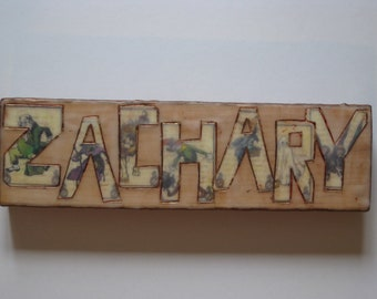 Painted Wood Nameplate with cut paper, wax, and oil paint.