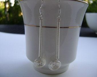 Wire wrapped long dangle  earrings.
