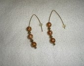 Pierced earrings marble colored brown. gold and white. metal gold tone spacers and earrings. One of a kind