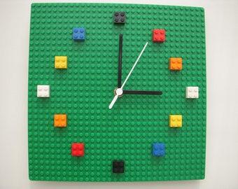 Multicolour LEGO® bricks and baseplate wall clock