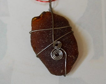 brown wire-wrapped sea glass pendant