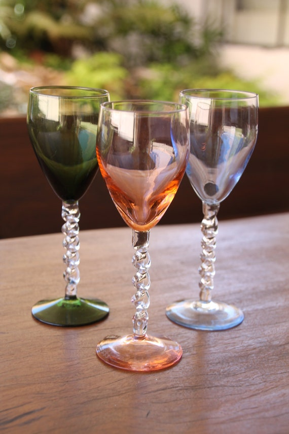 Vintage colored wine glasses with a spiral stem.