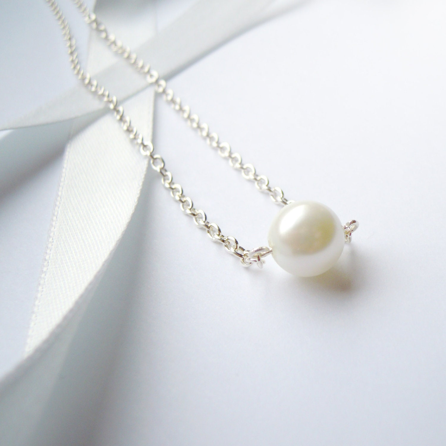 simple elegant pearl necklace on silver chain by