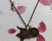 Antiqued brass charm pendant