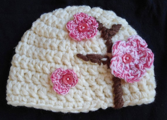 Crochet baby beanie (0-3 months) with cherry blossoms
