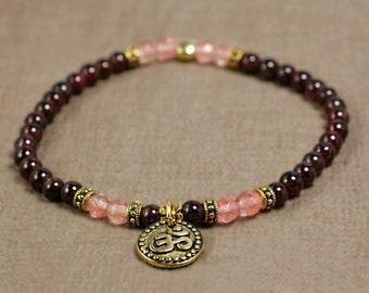 Little Doña women collection - garnet, cherry quartz, tibetan OHM charm bracelet