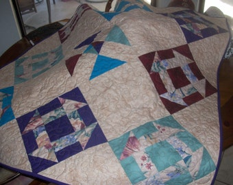 Quilted wall hanging or lap quilt, machine pieced and quilted perfect for any decor. multi-colored blocks set in beige background