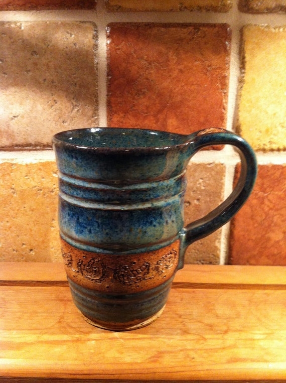 Hand thrown pottery mug etched with a botanical motif :)