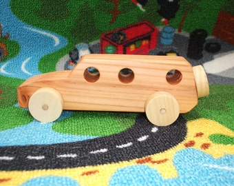 Beautiful, handcrafted, high quality wooden toy car (Outback).