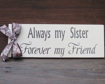 Wooden sign about Sisters