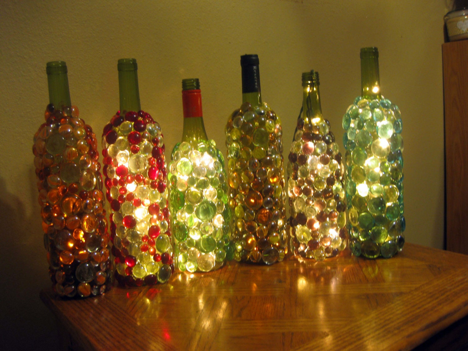 Items similar to glass gem embellished lighted wine for Glass bottles with lights in them