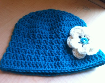 Women's teal hat with cream flower