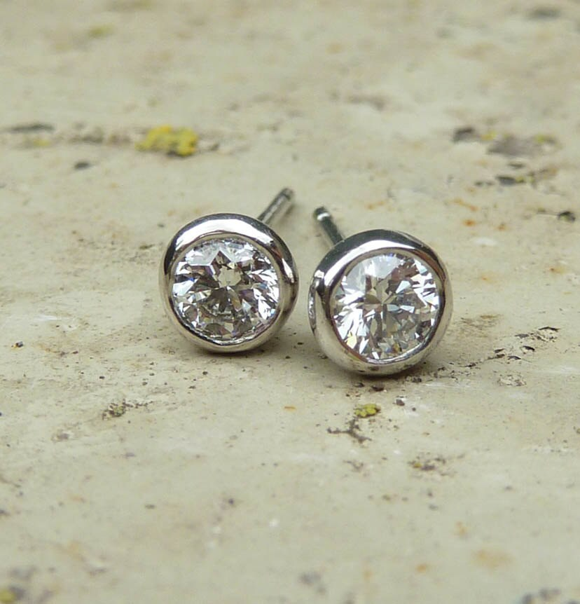 Diamond Stud Earrings Platinum Diamond Earrings. Rose Pendant. Perfect Engagement Rings. Cool Jewelry. Game Earrings. Sapphire Rings. Mens Diamond. Intertwined Wedding Rings. Fork Pendant