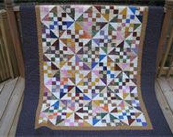 Bed Quilt.  Machine quilted. Hand sewn binding.