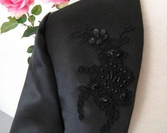 Black jacket, bolero, lace, party, on a dress.