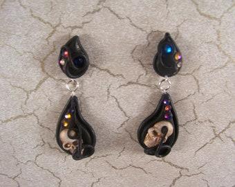 Asymmetrical polymer clay and Swarovski Crystal teardrop earrings with teeny skulls.